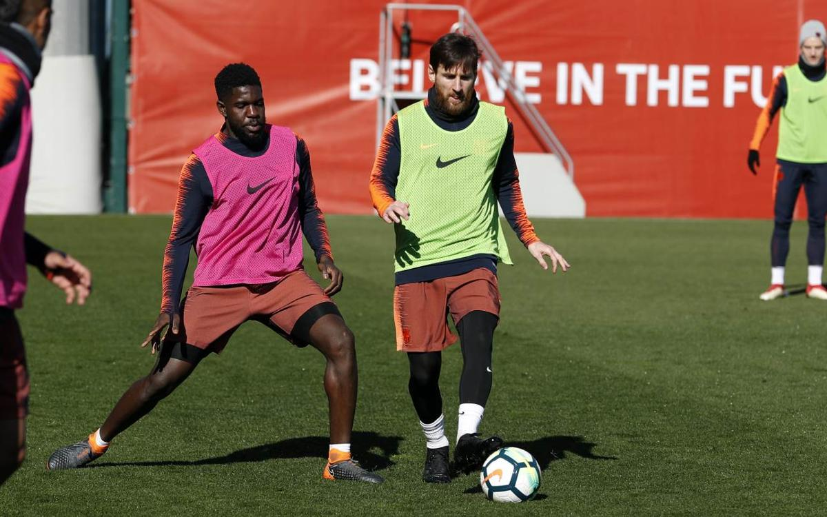 Lionel Messi and Samuel Umtiti, working hard in the training ground rondo