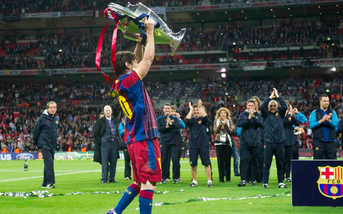 Leo Messi lifting one of four Champions League trophies won in his time with the club