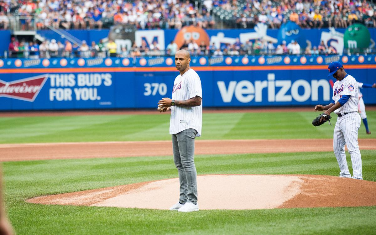 FC Barcelona Legend Thierry Henry throws out first pitch before New York Mets game at Citi Field