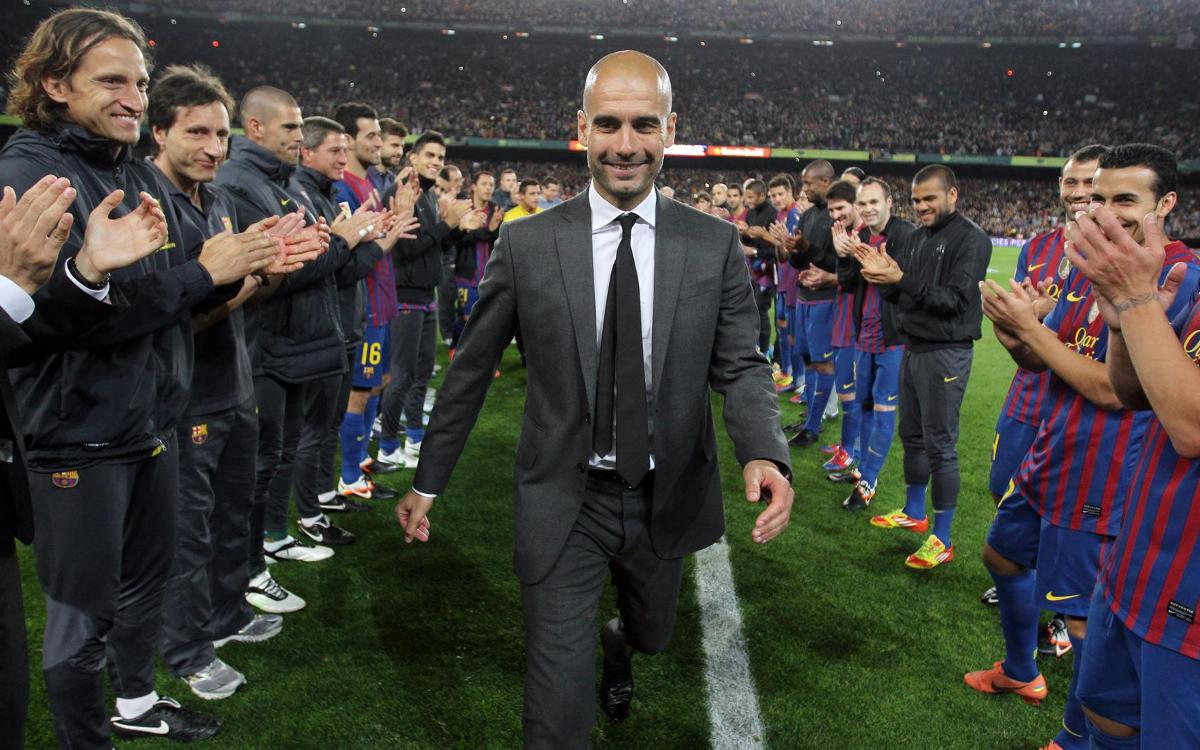 Players and staff celebrate Guardiola in his last game at the Camp Nou.