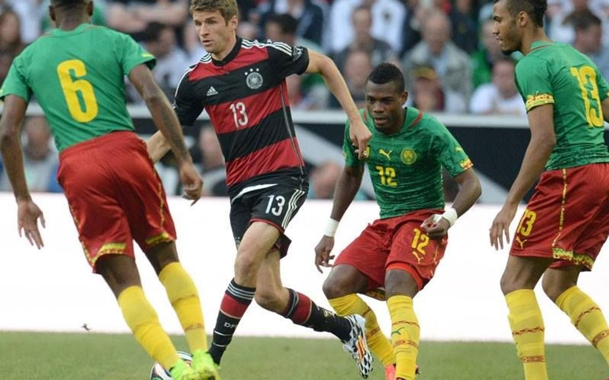 Song's Cameroon tough for Germany (2-2)