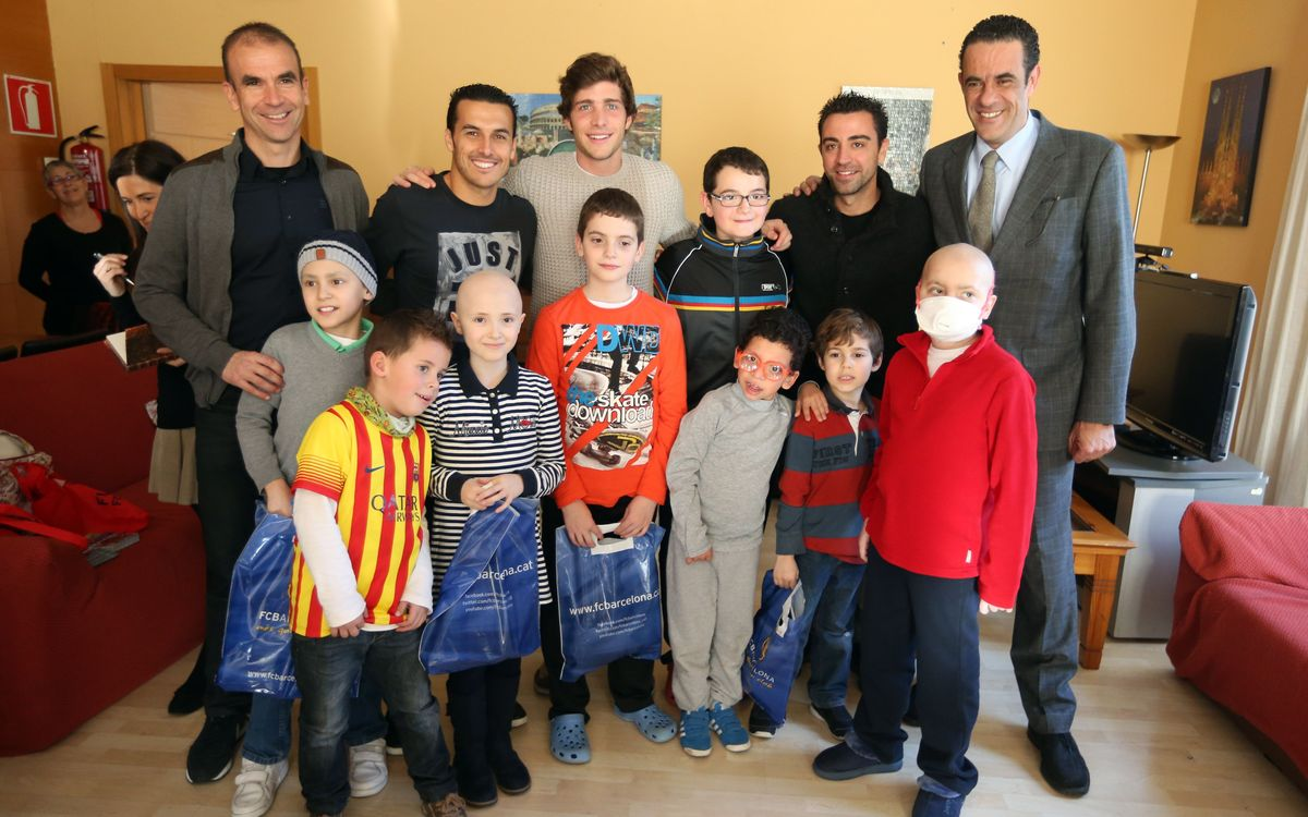 FC Barcelona players deliver gifts to hospitals