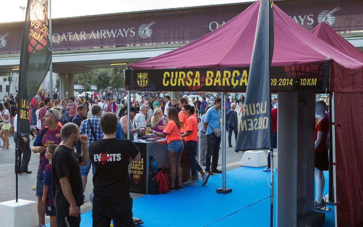 Dos stands informativos para promocionar la Cursa Barça 2014