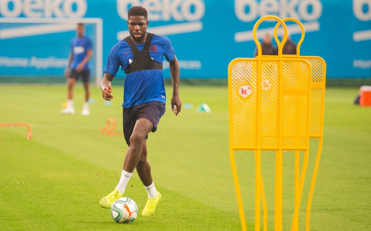 Umtiti i Junior fan part de l'entrenament