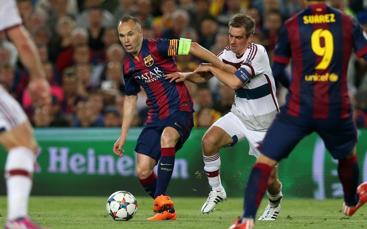 Iniesta and Lahm.