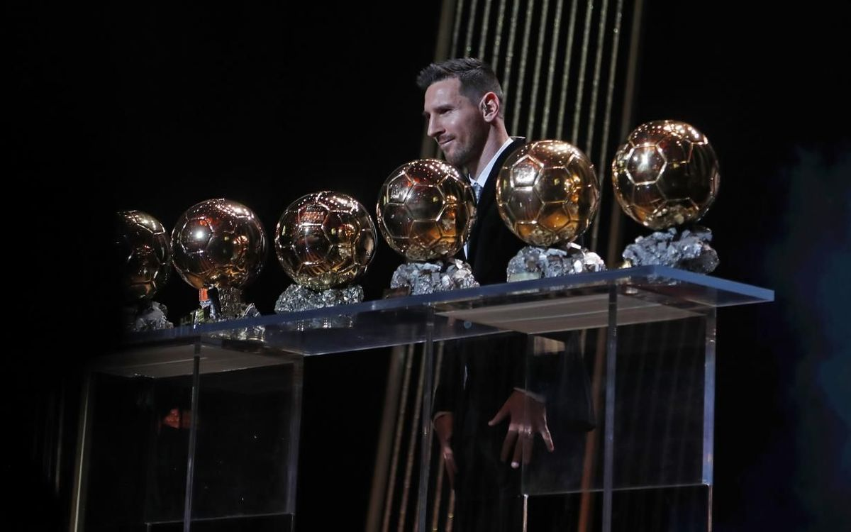 Messi with his Ballon d'Or awards.
